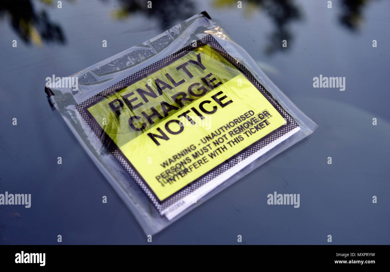 Penalty Charge Notice on motorists car, Petersfield, Hampshire, UK. - Stock Image
