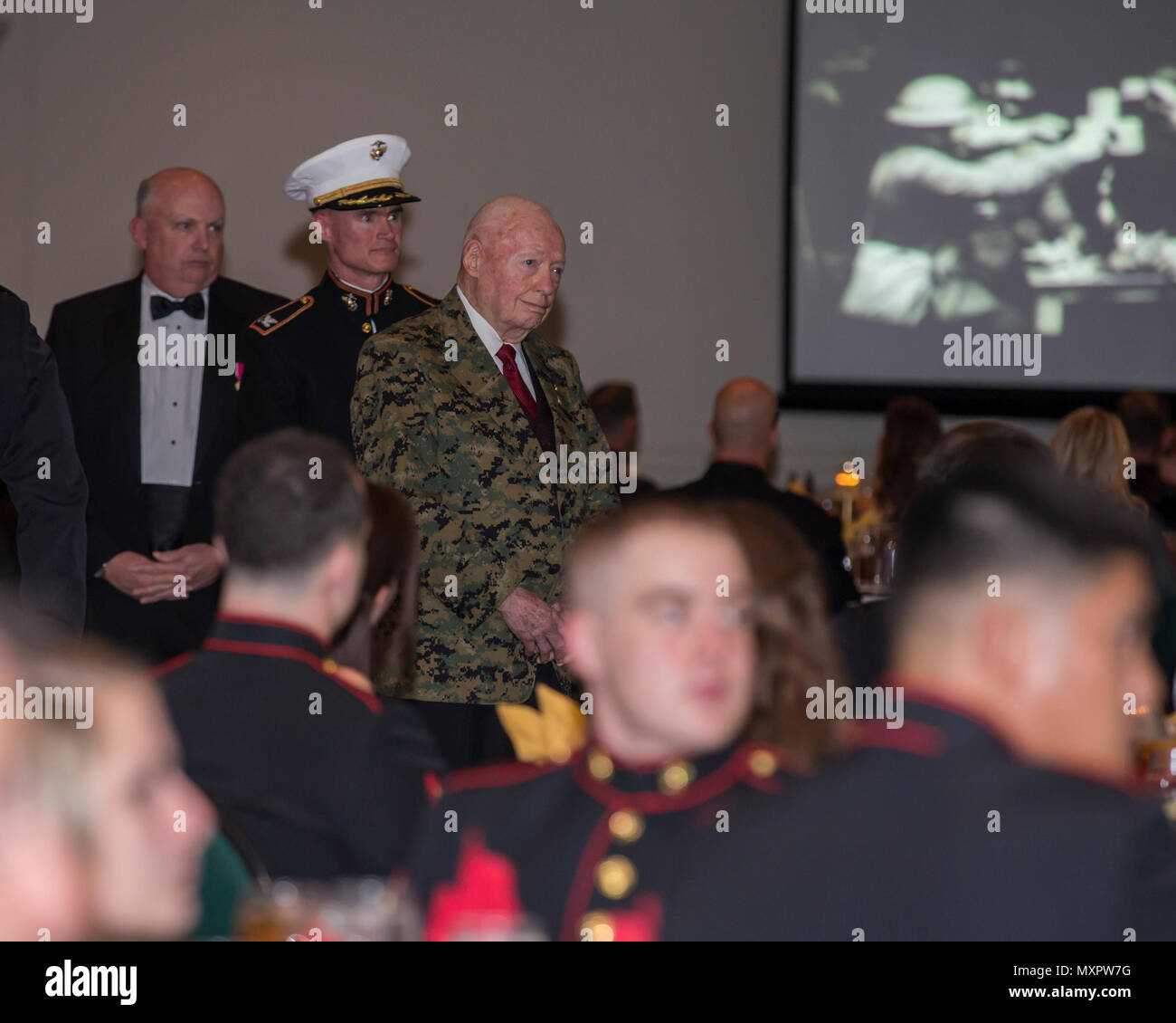 U.S. Marine Corps Gen. Alfred Gray (ret.), 29th Commandant of the Marine Corp, watches the birthday message of the 37th Commandant of the Marine Corp Gen. Robert Neller at Marine Corps Intelligence Activity's 241st Marine Corps birthday ball ceremony at the Fredericksburg Expo and Conference Center in Fredericksburg, Va., Nov. 10, 2016. The Continental Marines were established on this date in 1775, and the United States Marine Corps celebrates every year with a traditional birthday ball and cake-cutting ceremony. (U.S. Marine Corps photo by Cpl. Jacqueline A. Garcia) Stock Photo