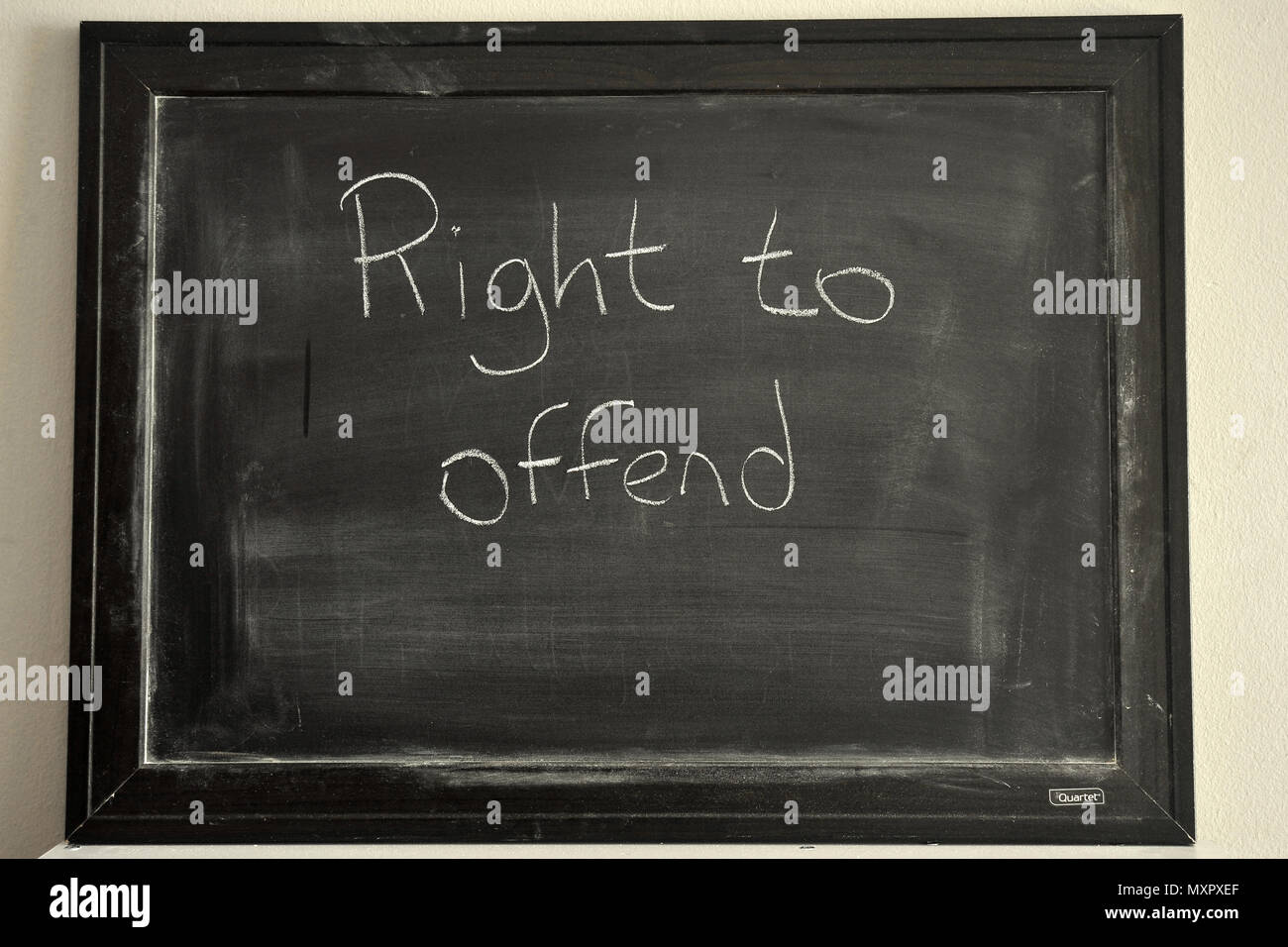 Right to offend written in white chalk on a blackboard - Stock Image