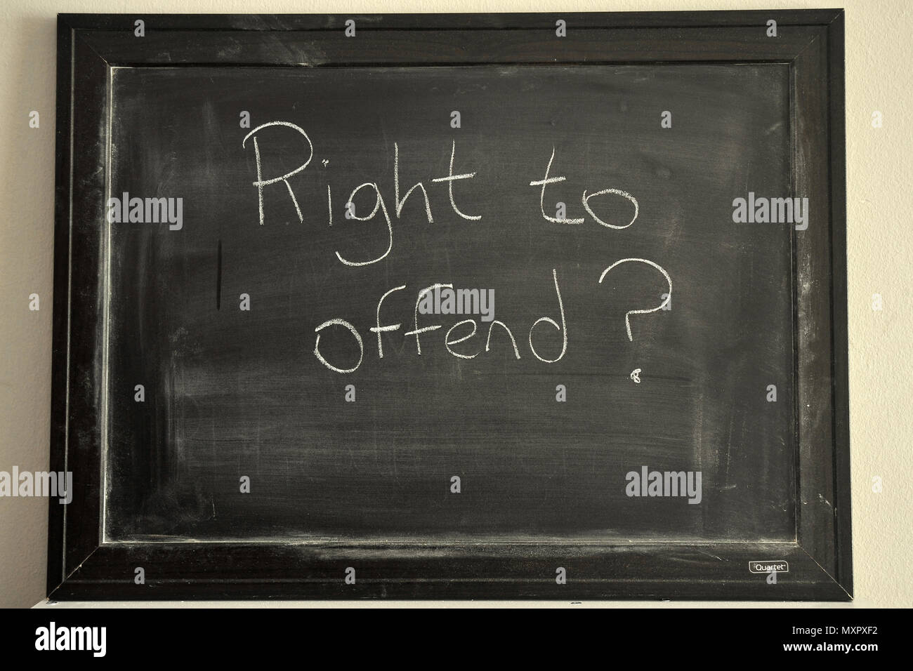 Right to offend written in white chalk on a blackboard Stock Photo