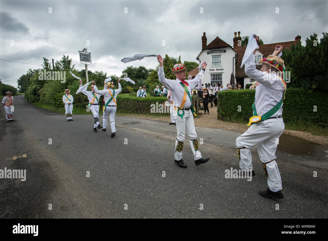 Thaxted Morris Weekend 2-3 June 2018 Lincoln and Micklebarrow Morris Dancing side outside the Farmhouse Inn, Monk Street, Thaxted - Stock Image