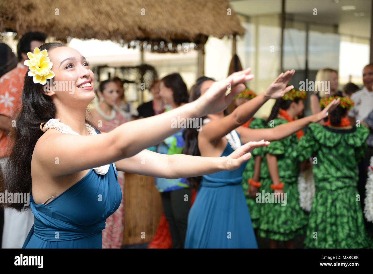 hula dancers provide entertainment prior to the arrival of an