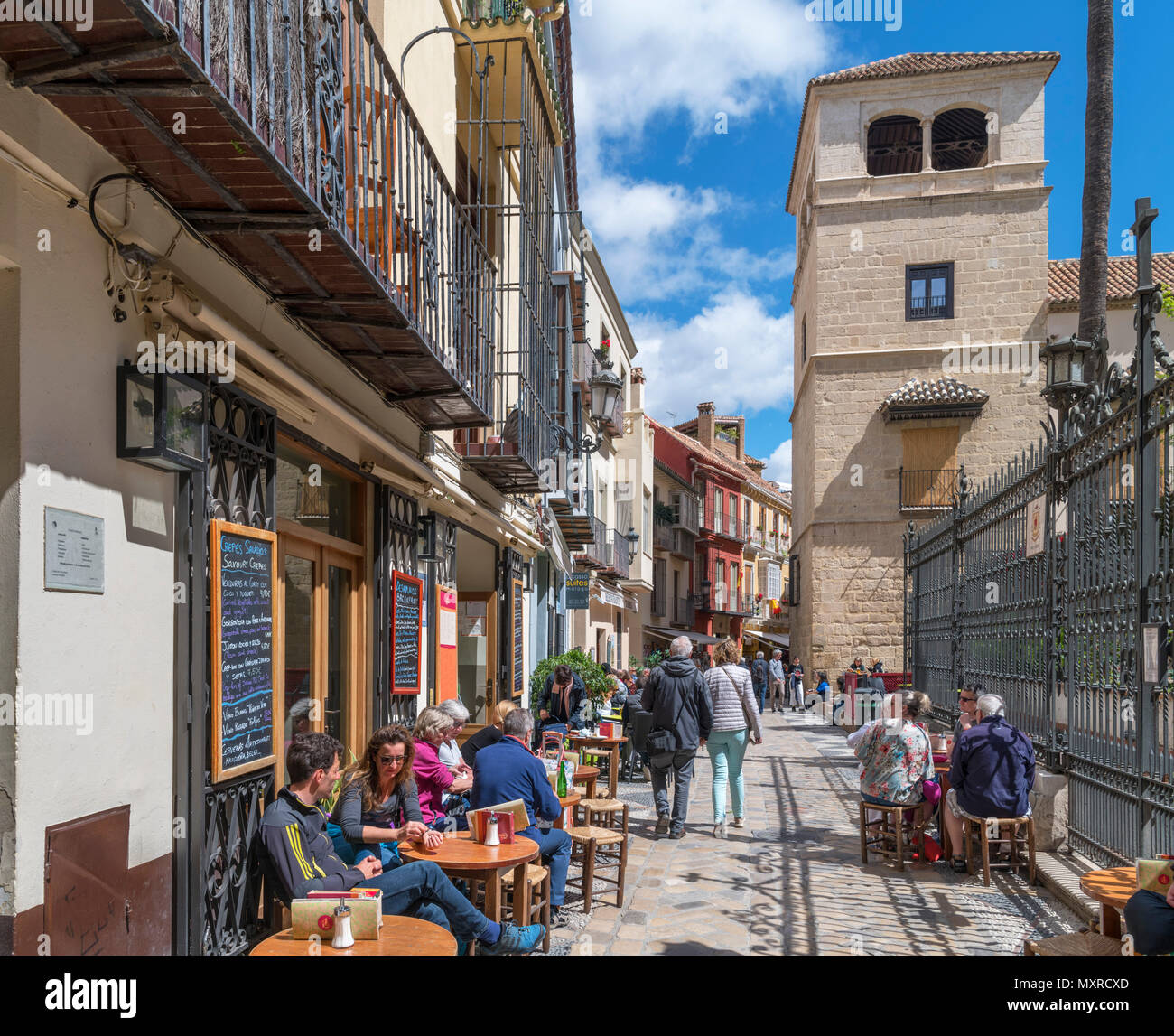 Cafe on Calle San Agustín looking towards the Picasso Museum, Malaga, Costa del Sol, Andalucia, Spain - Stock Image