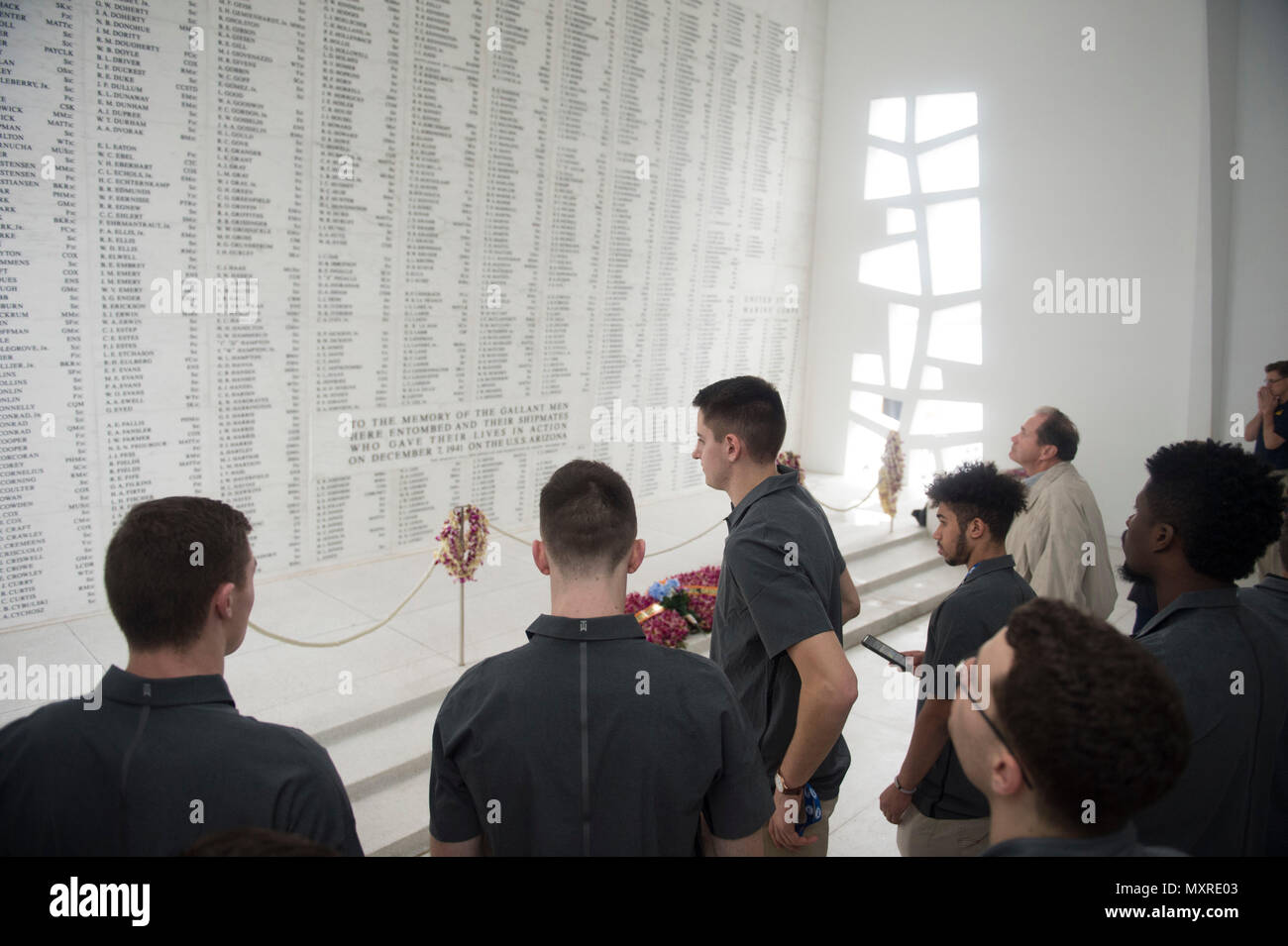 161204-N-ZK021-046 PEARL HARBOR (Dec. 4, 2016) Players from Princeton University view the names of Sailors who lost their lives during the attack on Pearl Harbor during a visit on the USS Arizona Memorial. The team is scheduled to participate in the FOX Sports Pearl Harbor Invitational on Dec. 6 and 7 along with players from Seton Hall University, University of California, and University of Hawaii. Dec. 7, 2016, marks the 75th anniversary of the attacks on Pearl Harbor and Oahu. As a Pacific nation, the U.S. is committed to continue its responsibility of protecting the Pacific sea-lanes, advan - Stock Image