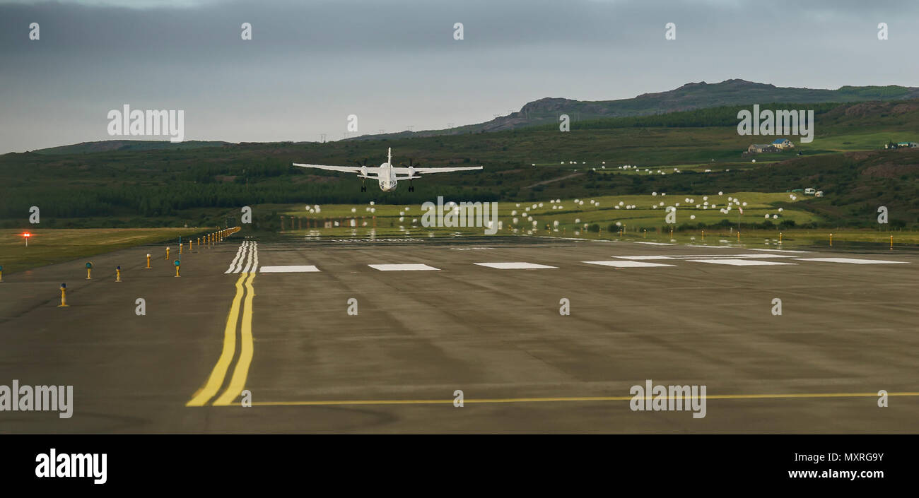 Plane taking off at Egilsstadir Airport, Eastern Iceland - Stock Image