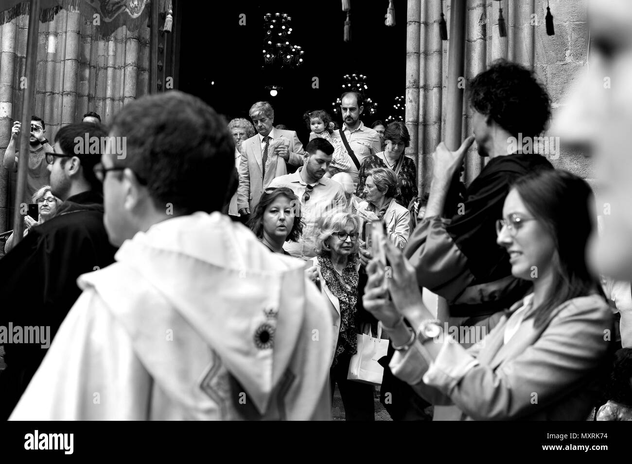 People exiting a church during a First Communion ceremony, Barcelona, Spain. - Stock Image