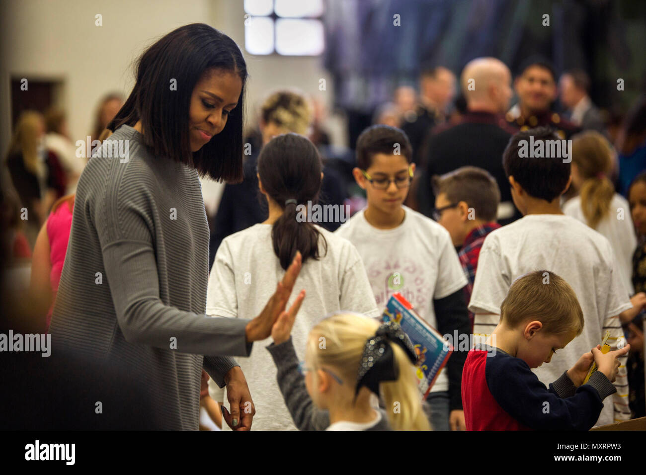 Toys For Tots Volunteer : First lady michelle obama high fives a volunteer at a toys for