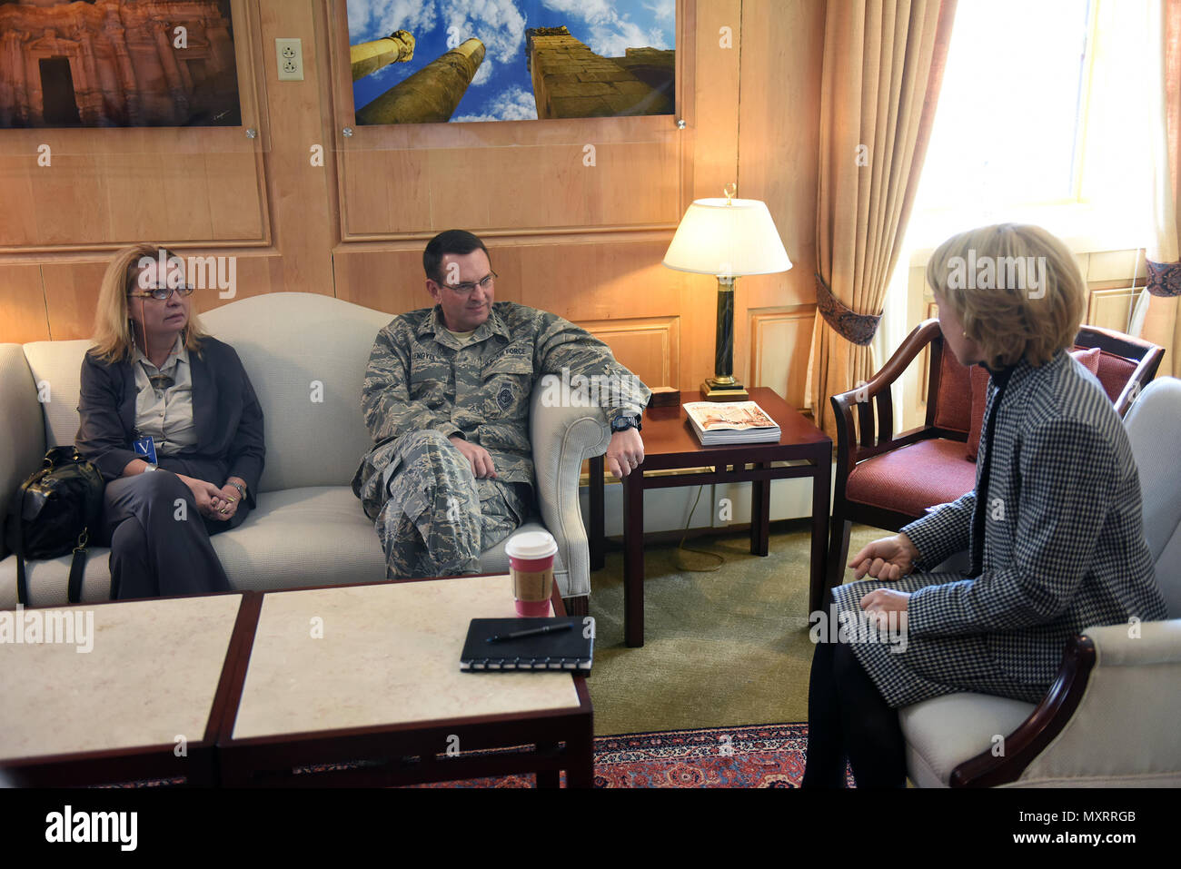 Ambassador Tatiana Gfoeller, left, foreign policy advisor to the chief of the National Guard Bureau, and Air Force Gen. Joseph Lengyel, chief, National Guard Bureau, talk with Ambassador Alice Wells, U.S. ambassador to the Hashemite Kingdom of Jordan, during a Thanksgiving troop visit, Nov. 27, 2016. (U.S. Army National Guard photo by Sgt. 1st Class Jim Greenhill) - Stock Image