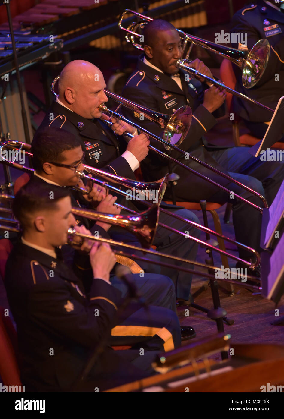 12/7/16- Spc. Samuel Dimov, Sgt. Francis Rivera-Murray, First Sgt. Charles Longfellow and Spc. Shawn Walker all play their trombone with the 287th Army Band at their annual Holiday Concert on the main stage at the Grand Opera House in Wilmington, Delaware, December 7, 2016. (U.S. Army National Guard photo by Staff Sgt. James Pernol/Released) - Stock Image