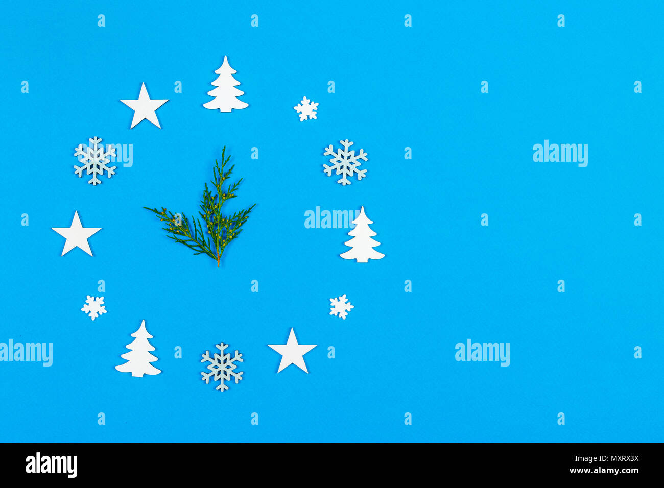 Concept clock made of christmas decoration showing five to midnight New Year on blue background with copy space. Stock Photo