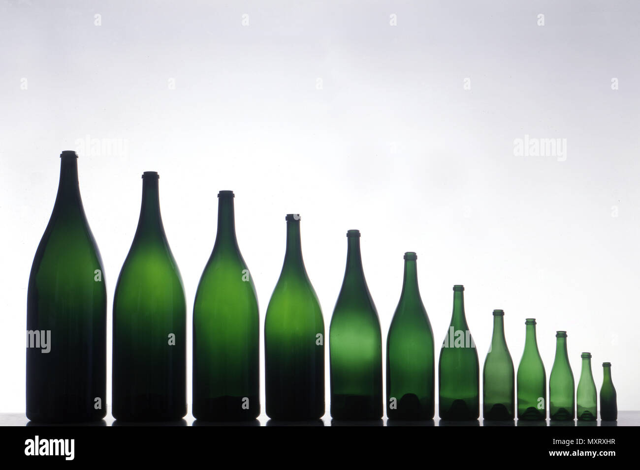 Manufacture of small bottles of Champagne, line of 12 bottles of Champagne of different size, from the smallest to the largest: 1/8 bottle (10cl), 1/4 - Stock Image