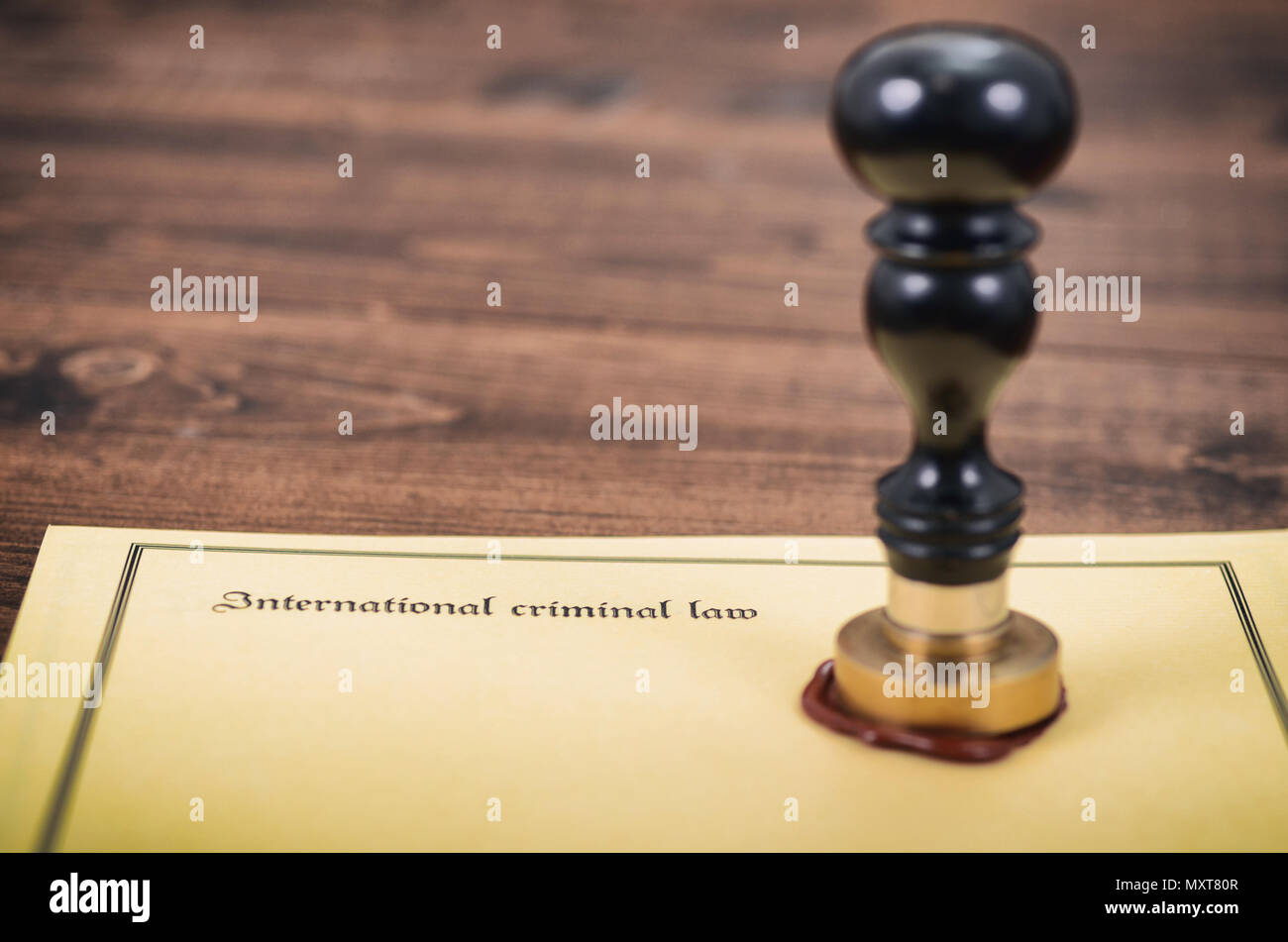 International criminal law, legality concept, notary seal, law and justice concept. - Stock Image