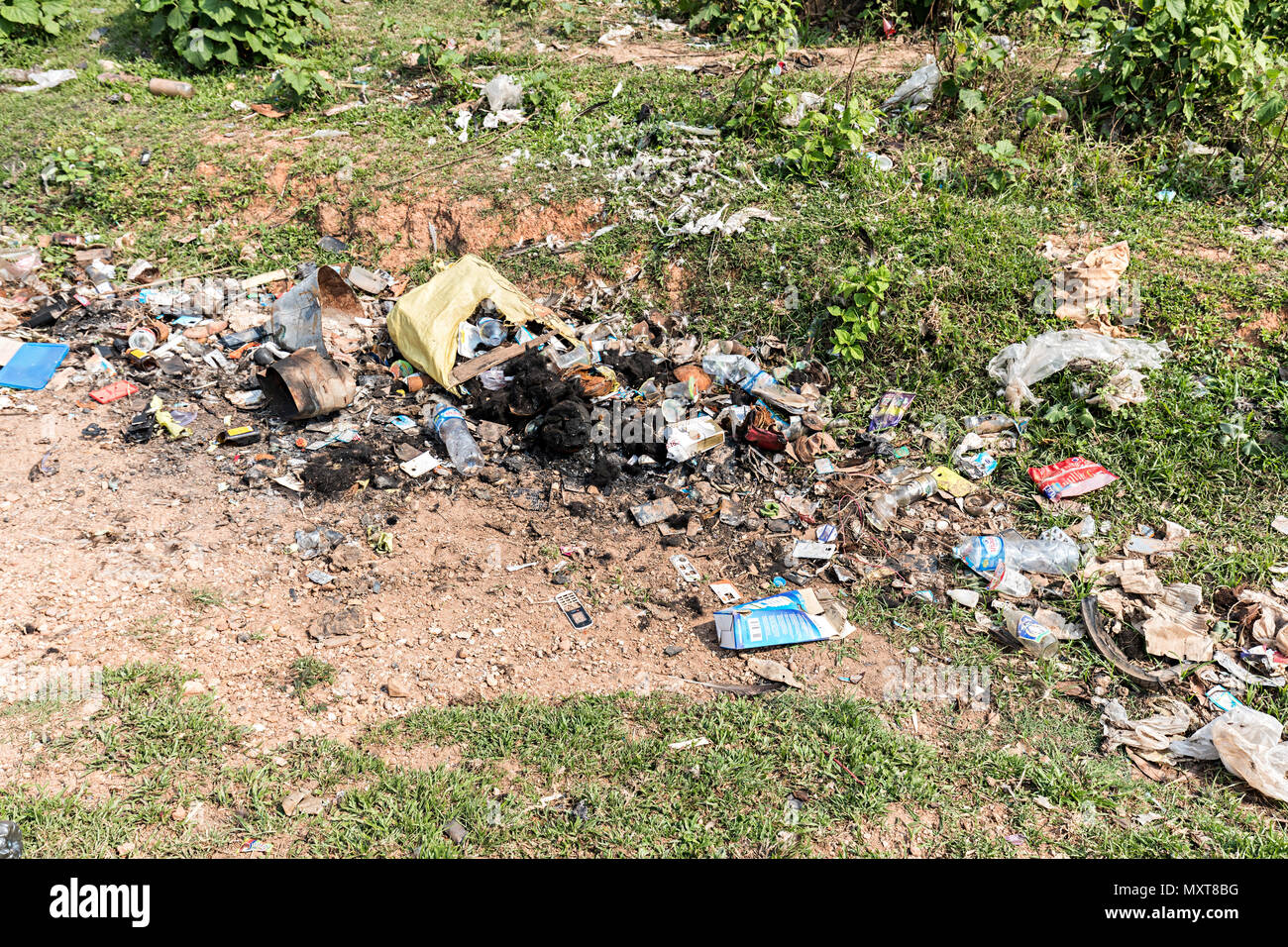 Rubbish left in ditch at side of road, Boualapha, Laos - Stock Image