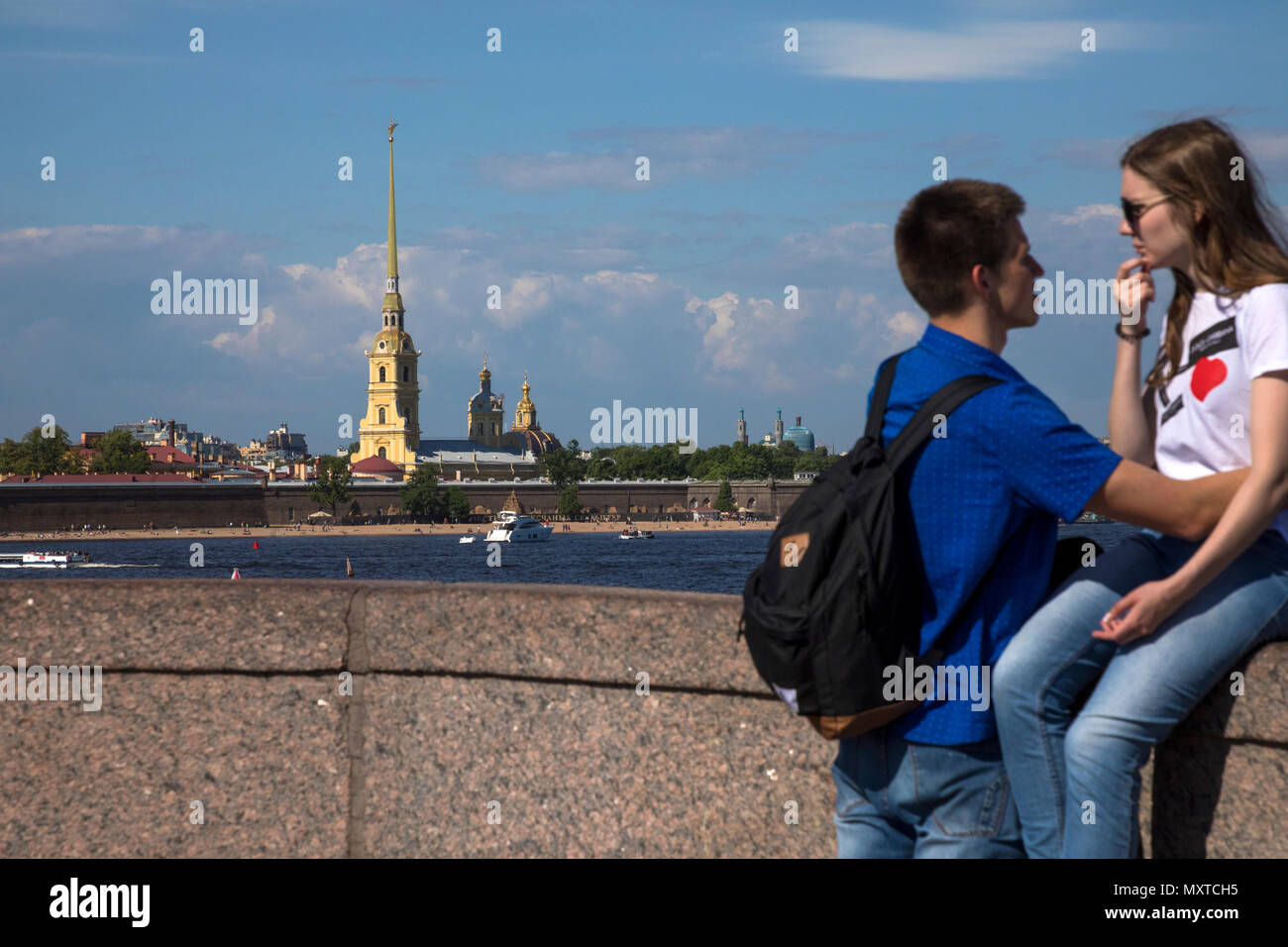 Summer view from the Palace Bridge to the Peter and Paul Fortress and the Neva River in the city center of St. Petersburg, Russia - Stock Image