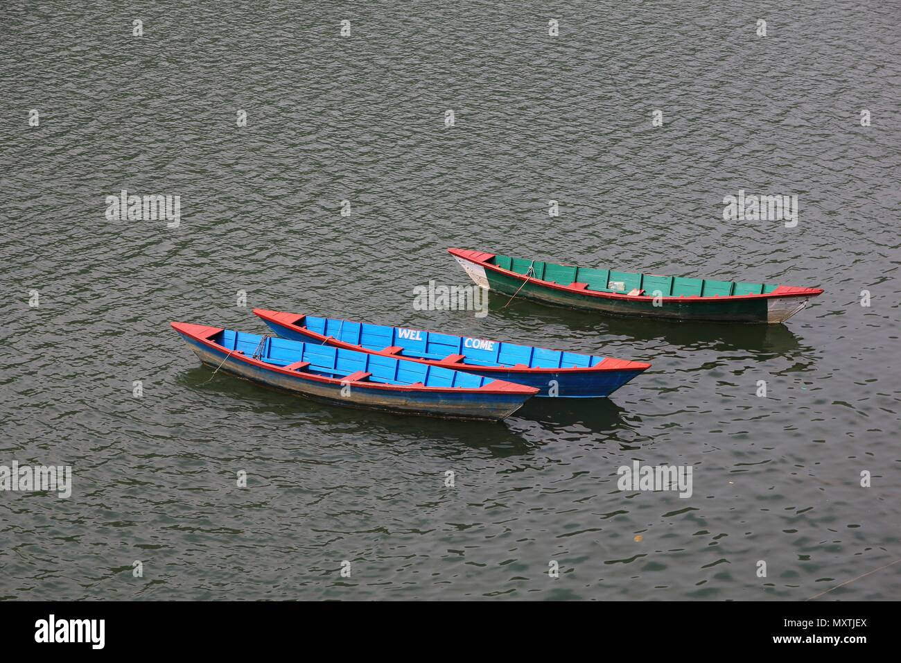 Timber rowing boats on Fewa lake, Pokhara. - Stock Image