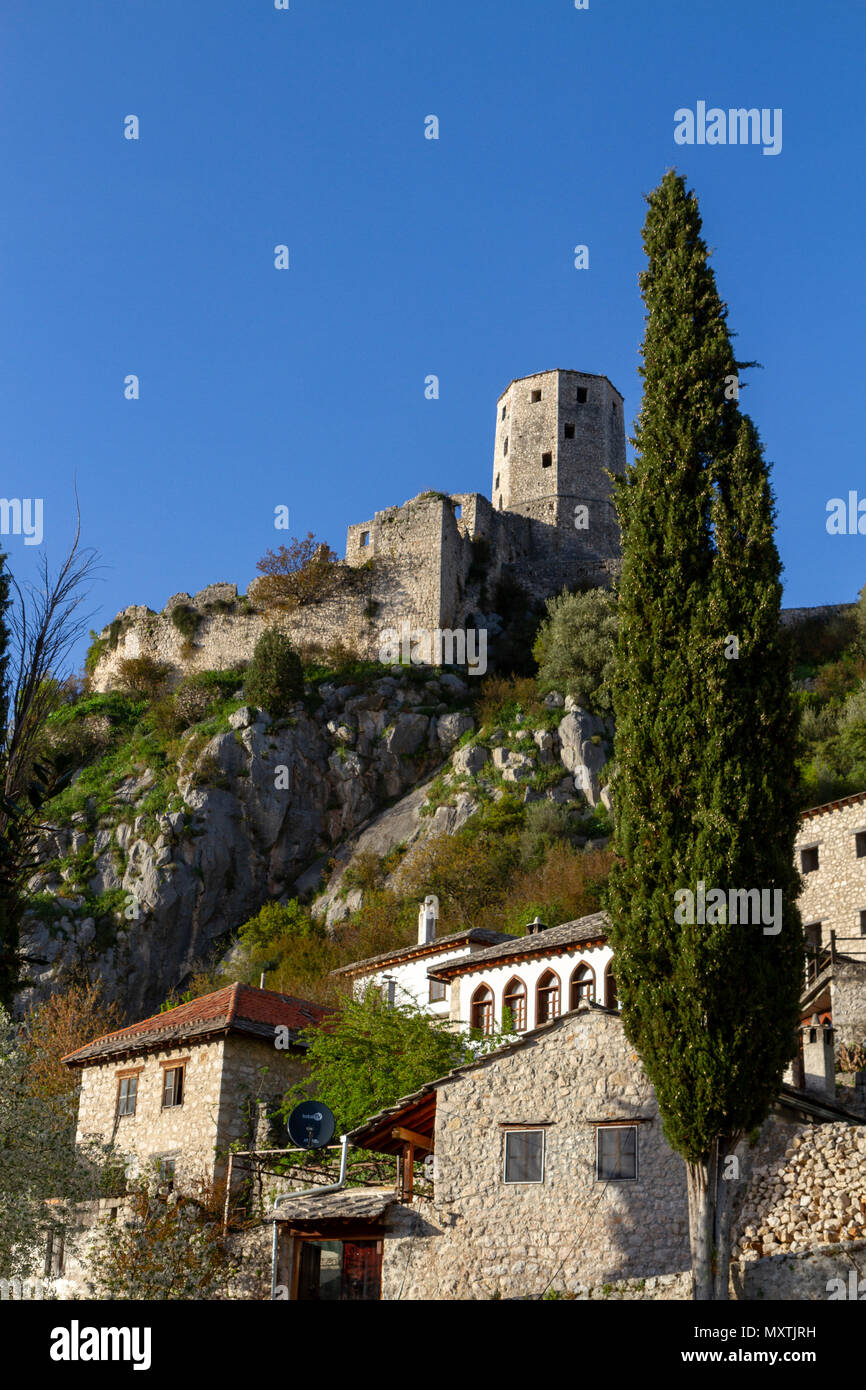 The Kula, overlooking the remains of Počitelj, a UNESCO-protected town, Federation of Bosnia and Herzegovina. - Stock Image