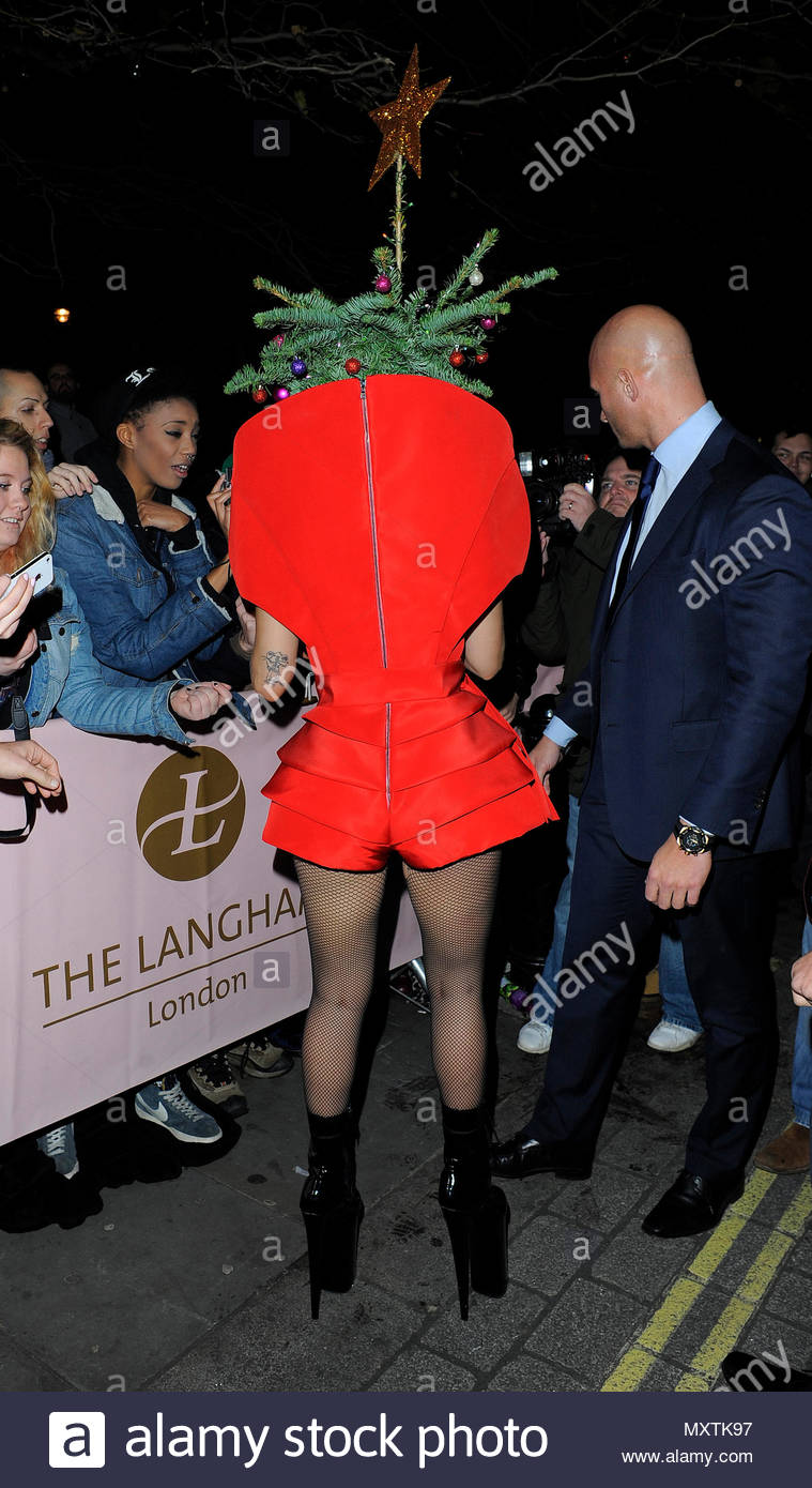 lady gaga lady gaga seen wearing red dress and a christmas tree on her head as she arrives back at the langham hotel after performing at the jingle bell