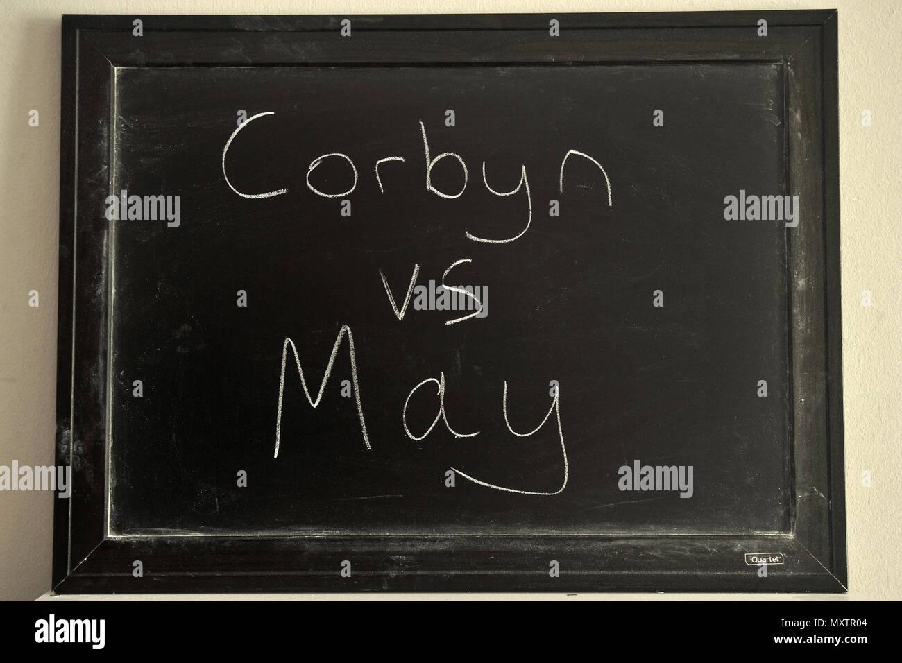 Corbyn vs May written in white chalk on a blackboard. - Stock Image
