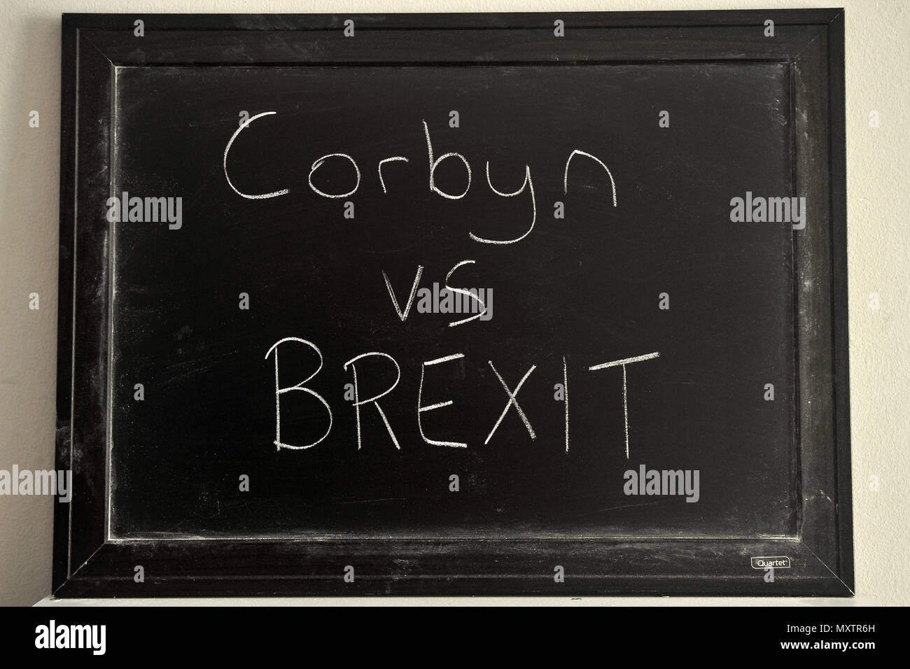 Corbyn vs BREXIT written in white chalk on a blackboard. - Stock Image
