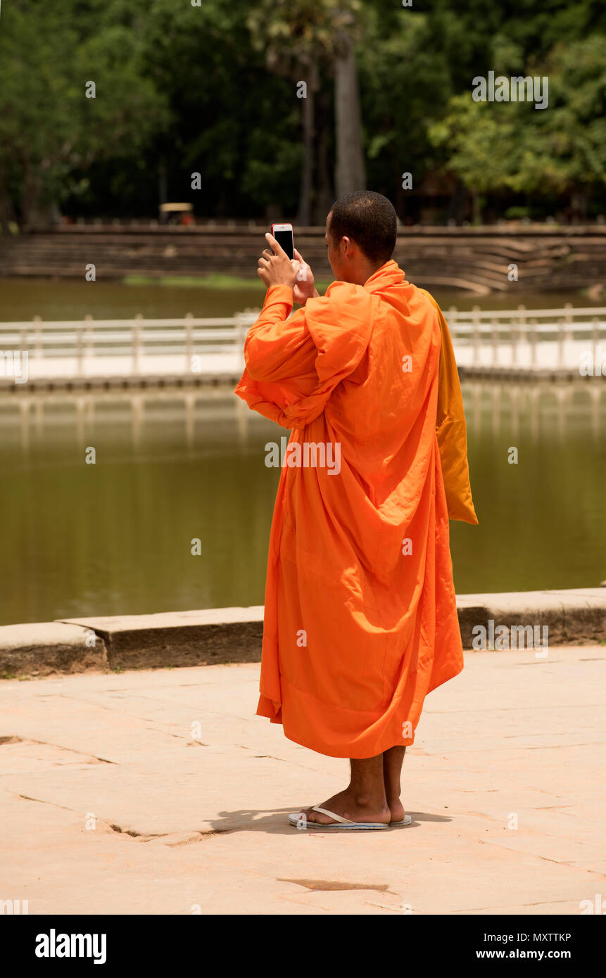 Cambodia, Siem Raep, Angkor, Angkor Vat, Monk and technology taking pix - Stock Image