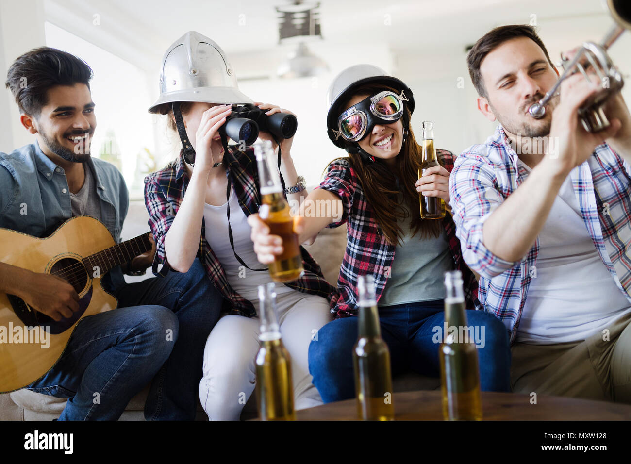 Group of happy young friends having fun and drinking beer Stock Photo