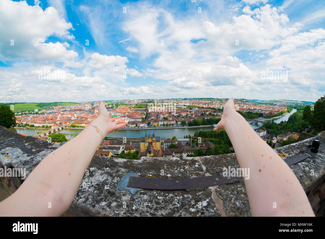 First person view from Festung Marienberg with arms in foreground on Würzburg, Germany Stock Photo