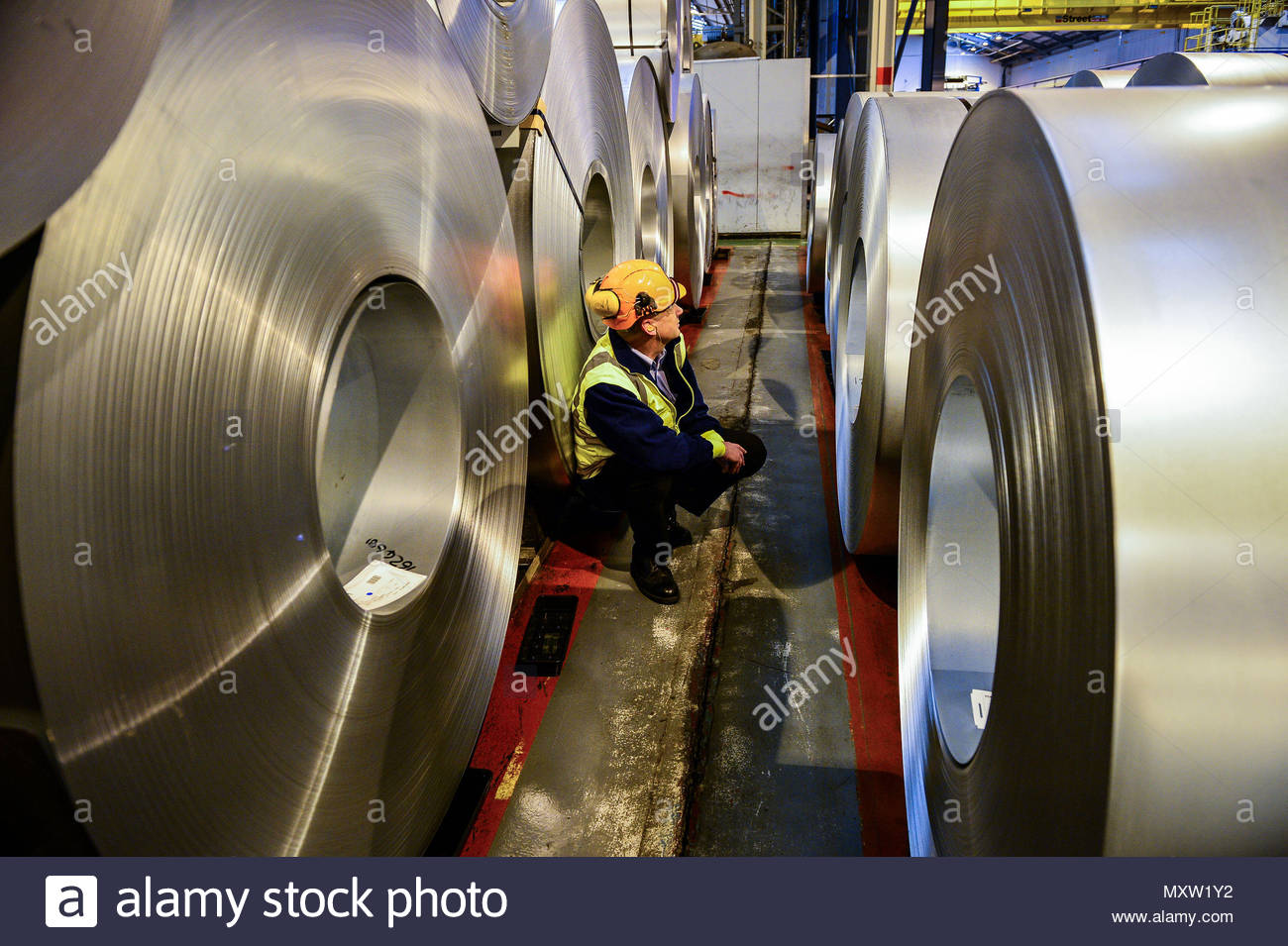 "File photo dated 15/02/17 of a worker inspecting rolls of steel. Theresa May has told President Donald Trump that US tariffs on EU steel are ""unjustified and deeply disappointing"". - Stock Image"