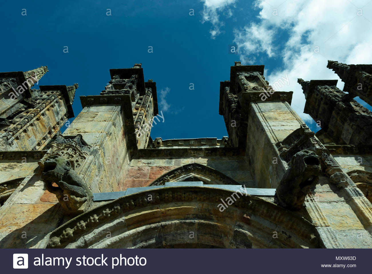Rosslyn Chapel, formally known as the Collegiate Chapel of St Matthew, is a 15th-century chapel located in the village of Roslin, Midlothian, Scotland - Stock Image