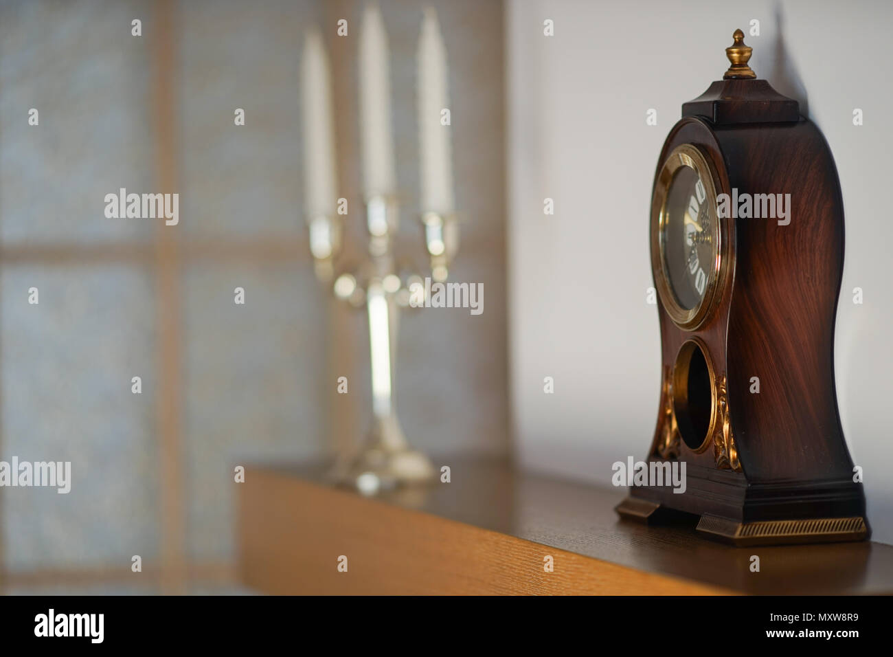 Mantelpiece with clock - Stock Image