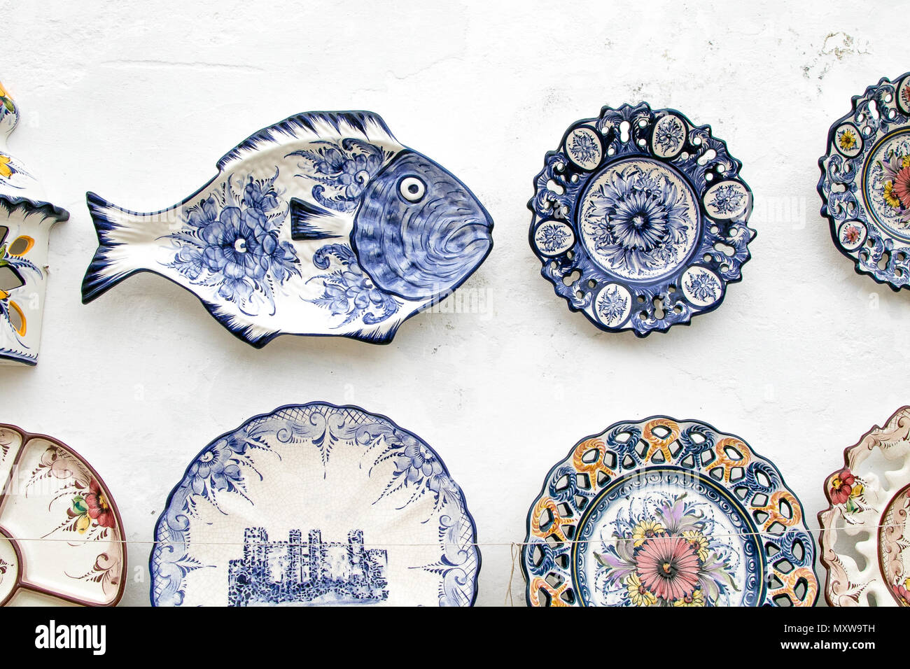 Touristy souvenirs for sale at the streets of Obidos, Portugal. - Stock Image