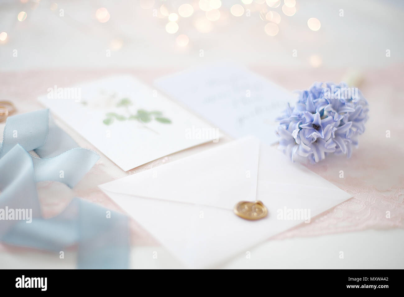 Wedding invitation card as a decorated letter with blurred lights on wedding invitation card as a decorated letter with blurred lights on background bokeh stopboris Images