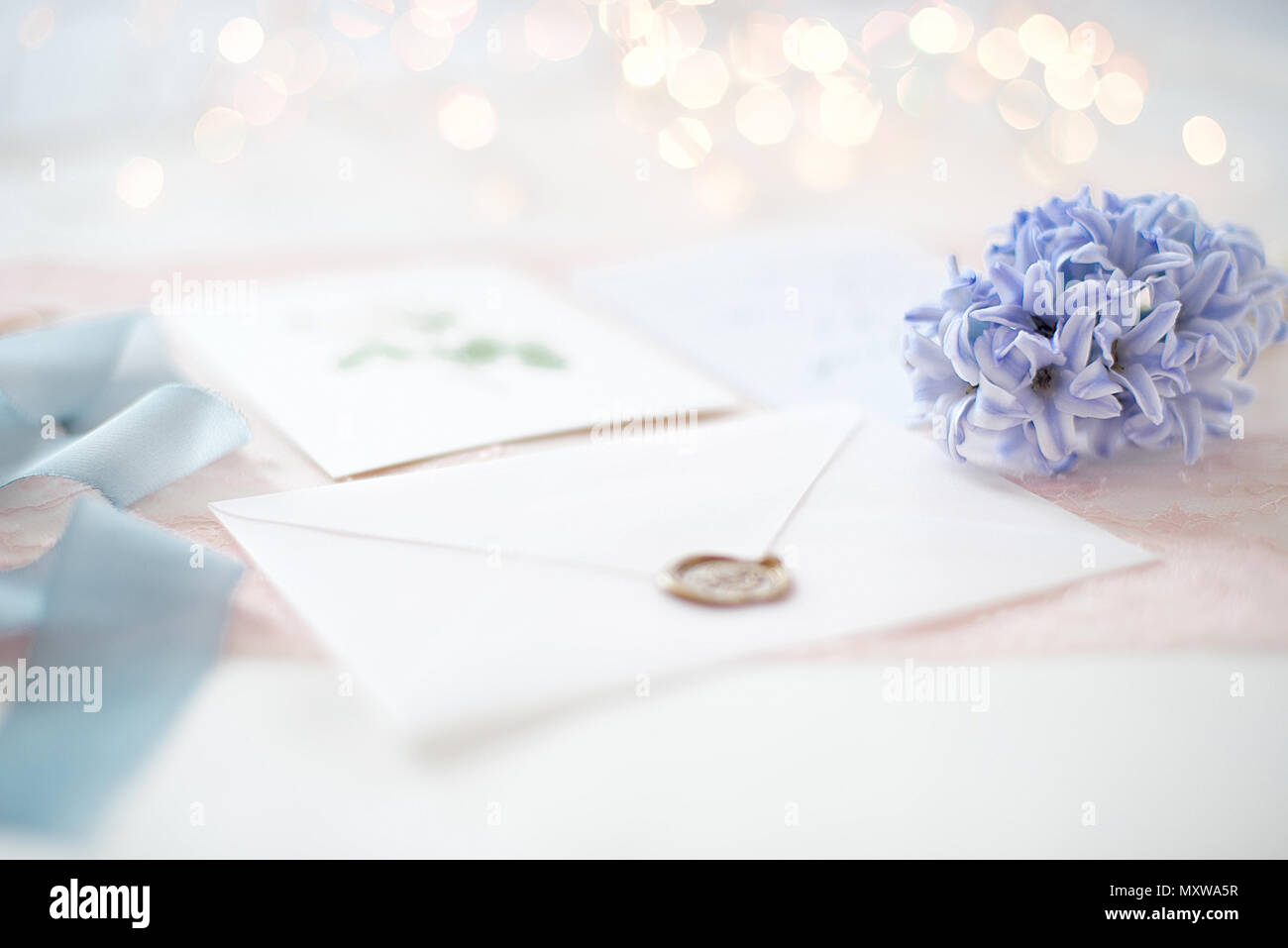 Wedding Invitation Card As A Decorated Letter With Blurred Lights On