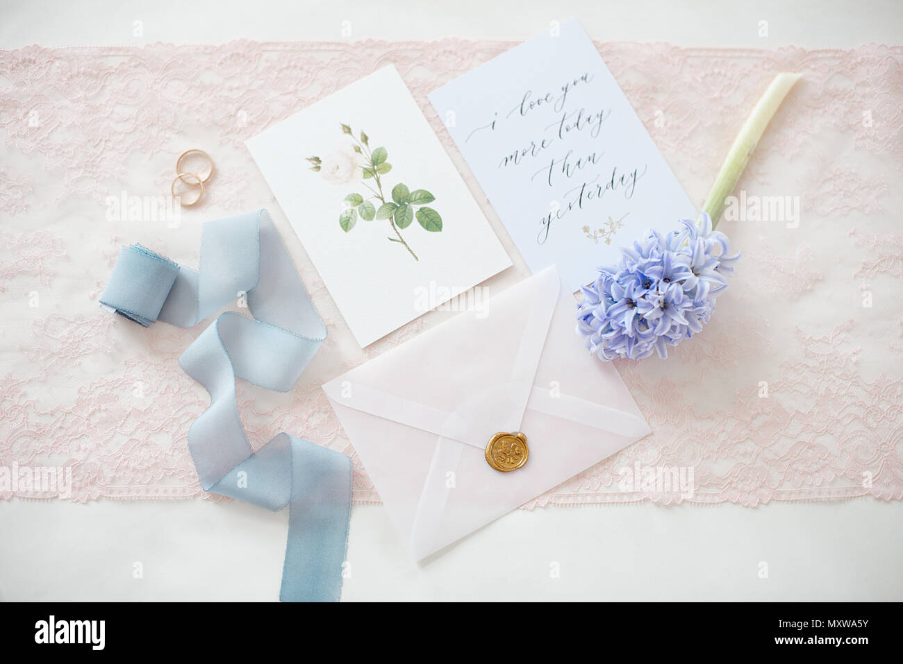 Wedding invitation card as a decorated letter with flowers and wedding invitation card as a decorated letter with flowers and ribbons top view m4hsunfo