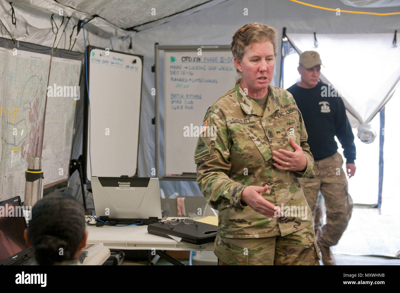 FORT BRAGG, North Carolina-- Sgt. Maj. Carolyn L. Sherratt briefs the Tactical Operations Center at Mackall Army Air Field on operation updates, Dec 12. The TOC is the head of mission control for Operation Toy Drop XIX. - Stock Image