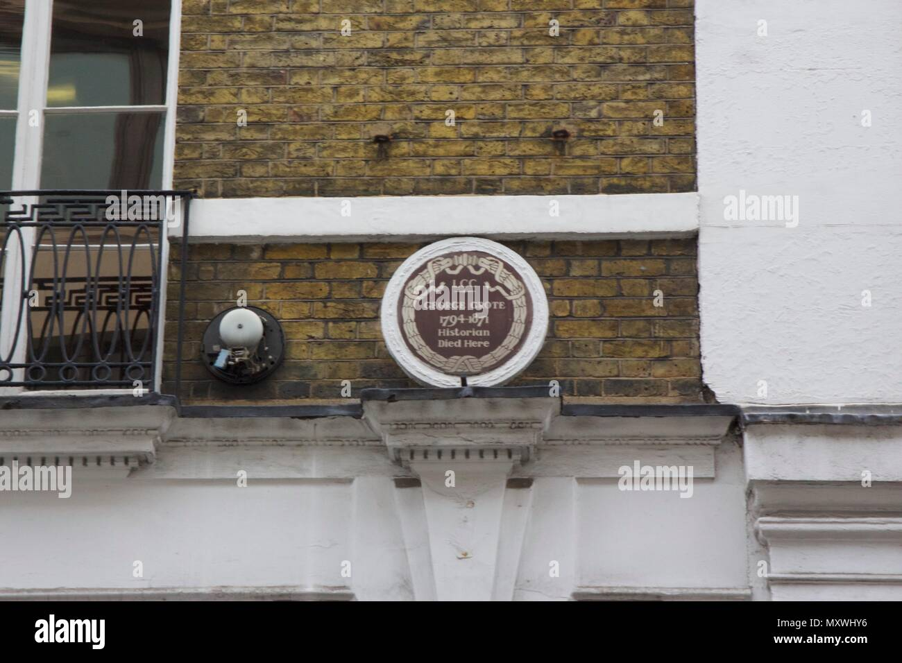 English heritage plaque for George Grote (1794-1871), a historian who died at 12 Savile Row, Mayfair, London - Stock Image