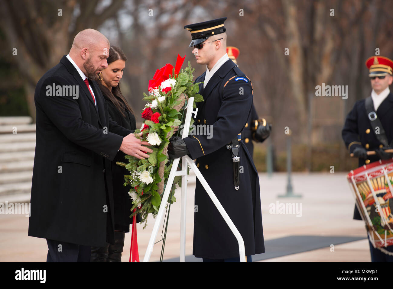 """From the left, WWE Paul """"Triple H"""" Levesque and WWE Chief Brand Officer Stephanie McMahon place a wreath at the Tomb of the Unknown Soldier in Arlington National Cemetery, Dec. 13, 2016, in Arlington, Va. WWE is scheduled to host its 14th annual Tribute to the Troops, in partnership with the USO Metro, in Washington, D.C. (U.S. Army photo by Rachel Larue/Arlington National Cemetery/released) - Stock Image"""