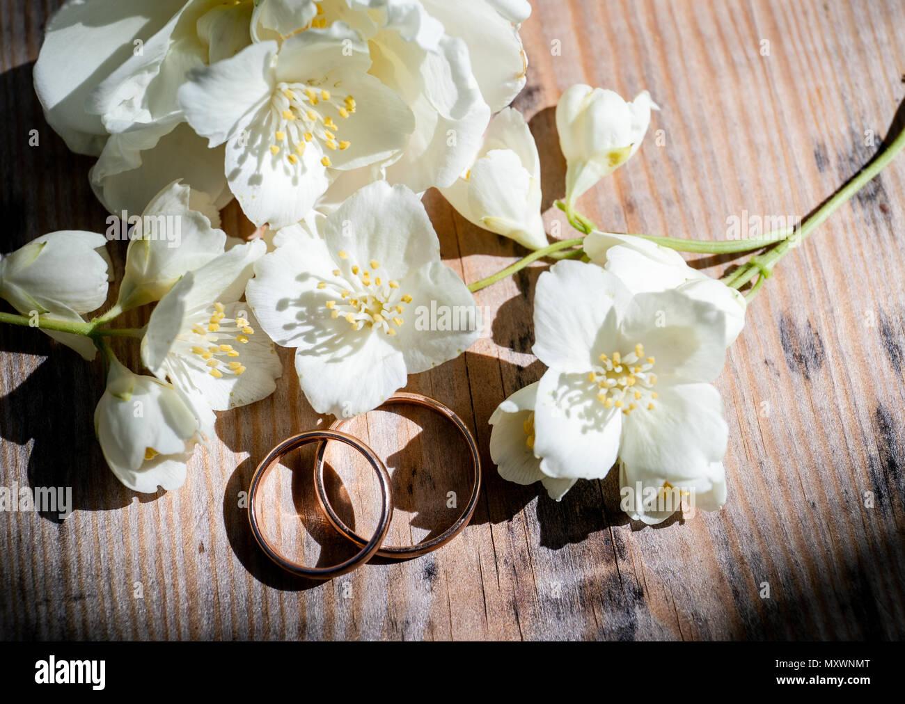Golden wedding rings on white jasmine flowers stock photo 188650584 golden wedding rings on white jasmine flowers izmirmasajfo