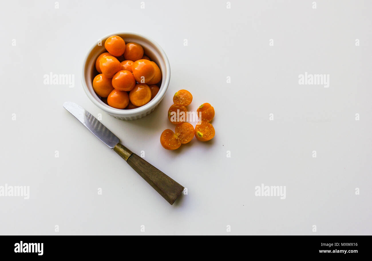 a bowl of golden sweet tangy cape gooseberries , an unique fruit to try - Stock Image