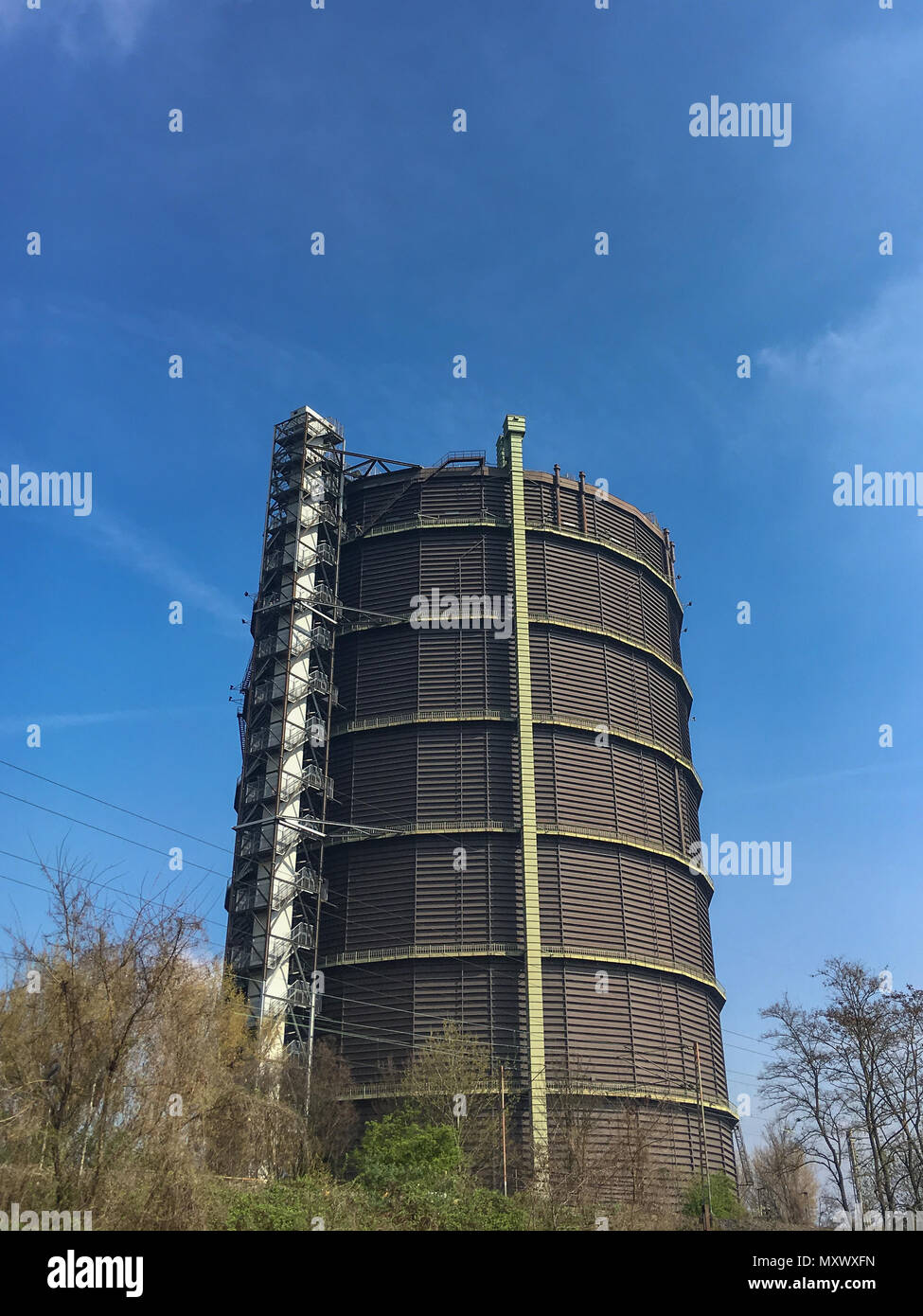 The Gasometer is an industrial monument and landmark of the city of Oberhausen. The former gas holder was built in the 1920s and is now a place for cu - Stock Image