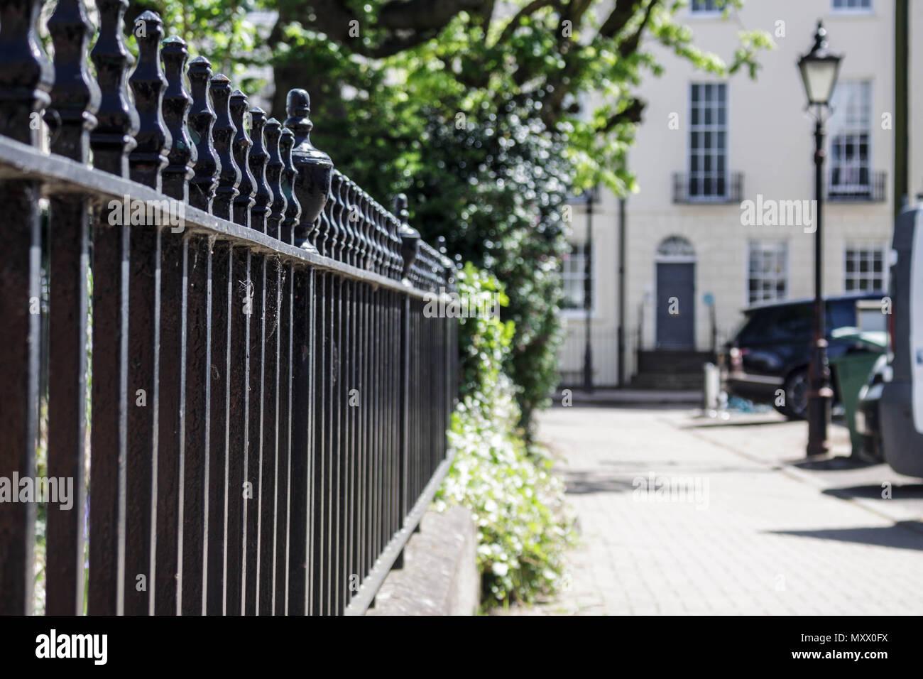 Street scene in a regency town in the UK. Image showing buildings, walls, shops, plants. Urban image. Stock Photo