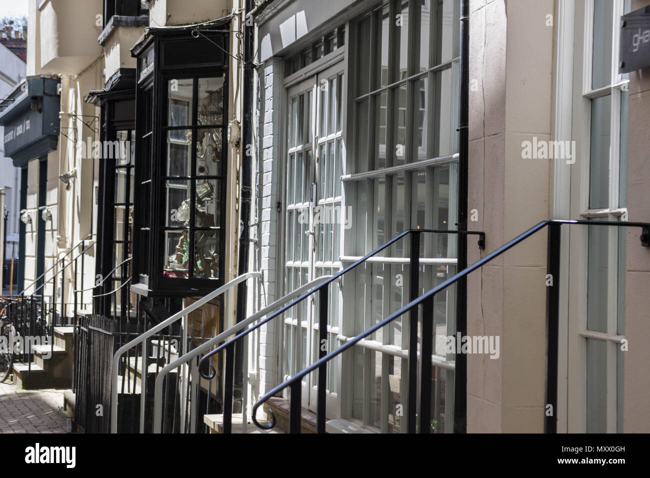 Street scene in a regency town in the UK. Image showing buildings, walls, shops, plants. Urban image. - Stock Image