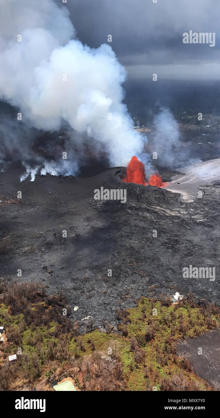 Aerial view of a massive lava fountain spewing magma 230 feet into the air from fissure 8 in the Vacationland area caused by the eruption of the Kilauea volcano June 3, 2018 in Hawaii. The recent eruption continues destroying homes, forcing evacuations and spewing lava and poison gas on the Big Island of Hawaii. - Stock Image
