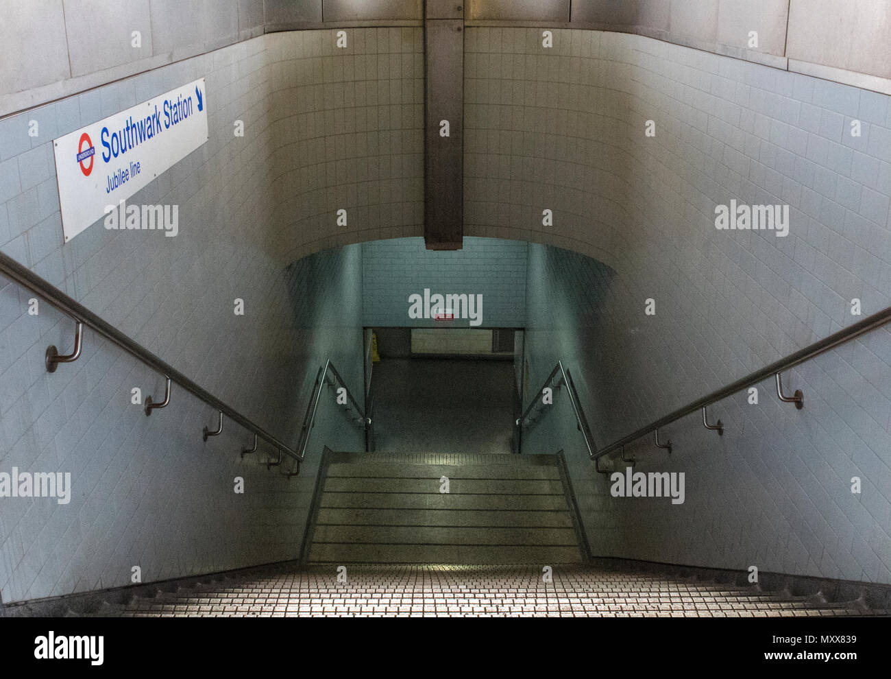 some dark and dingy stairs leadin down to a subway at waterloo east station leading to southwark tube station in central london. - Stock Image