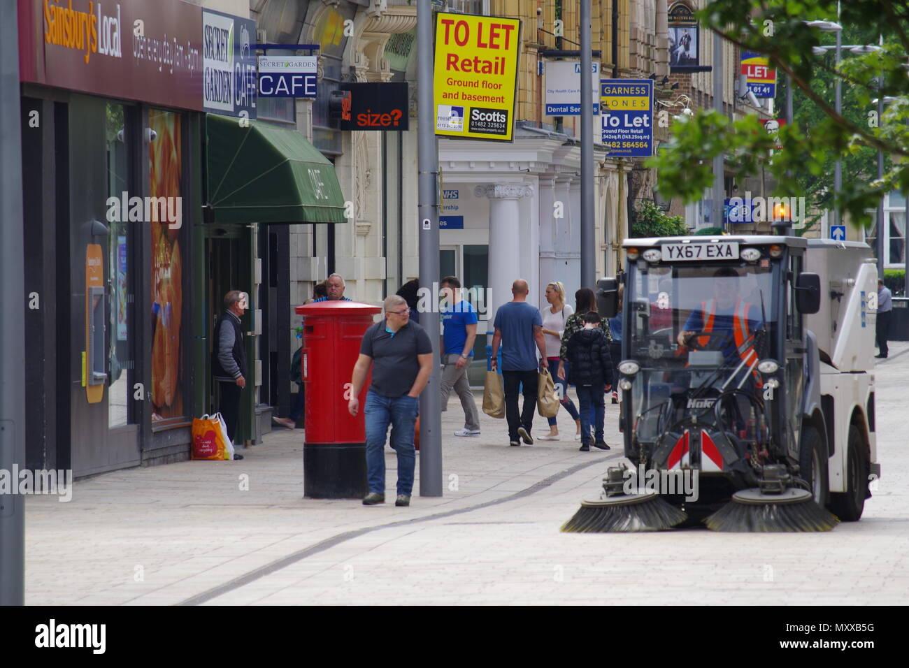 Street sweeping machine, Kingston upon Hull pedestrian precinct, UK - Stock Image