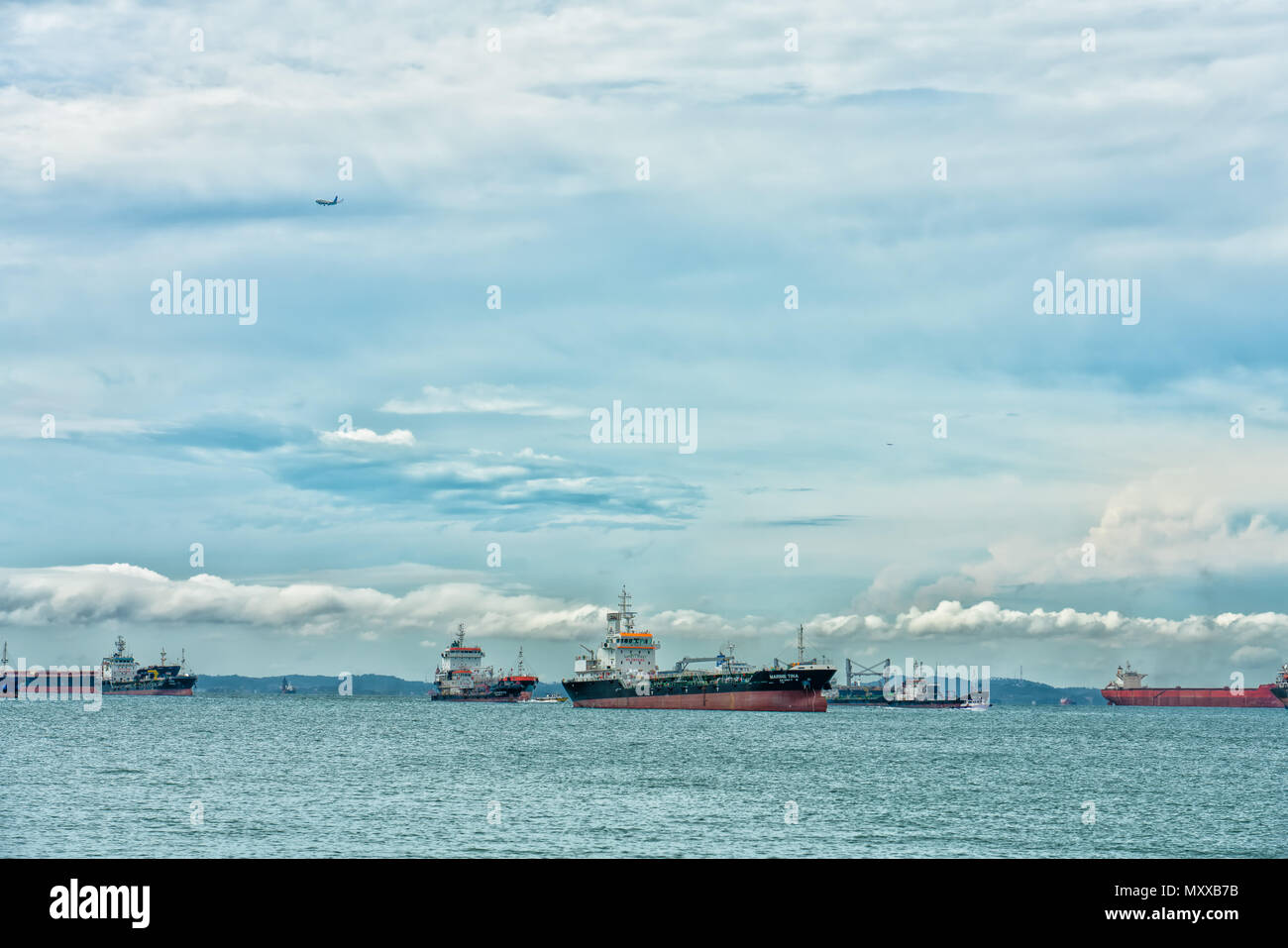 Ships waiting in Singapore Strait - Stock Image