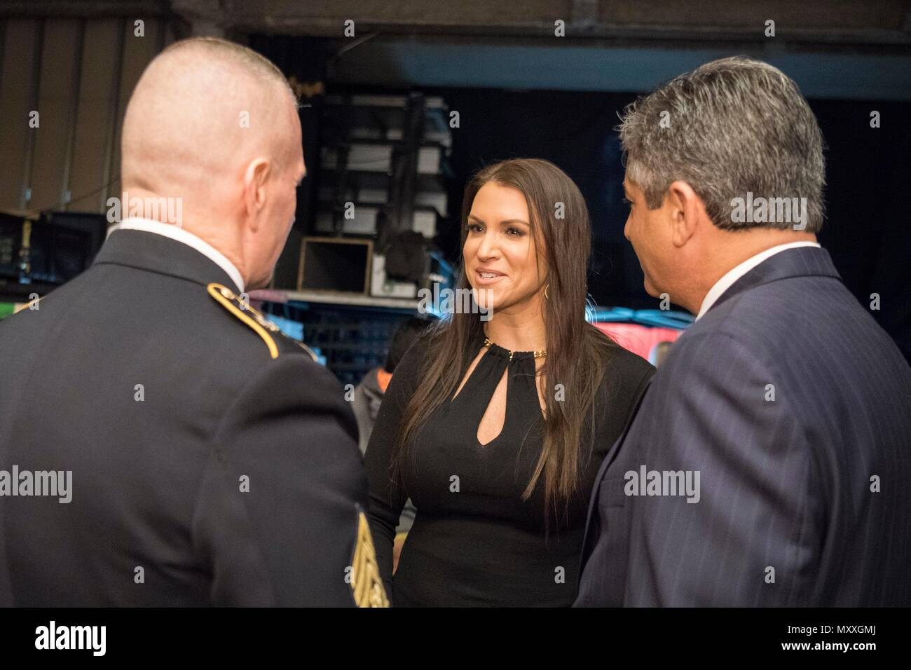 Army Command Sgt. Maj. John W. Troxell, Senior Enlisted Advisor to the Chairman of the Joint Chiefs of Staff, speaks to Stephanie McMahon, Wrestler and Chief Brand Officer of WWE, backstage during the 14th Annual Tribute to the Troops Event at the Verizon Center in Washington, D.C., Dec. 13, 2016. WWE Tribute to the Troops is an annual event held by WWE and Armed Forces Entertainment in December during the holiday season since 2003, to honor and entertain United States Armed Forces members. WWE performers and employees travel to military camps, bases and hospitals, including the Walter Reed Ar - Stock Image