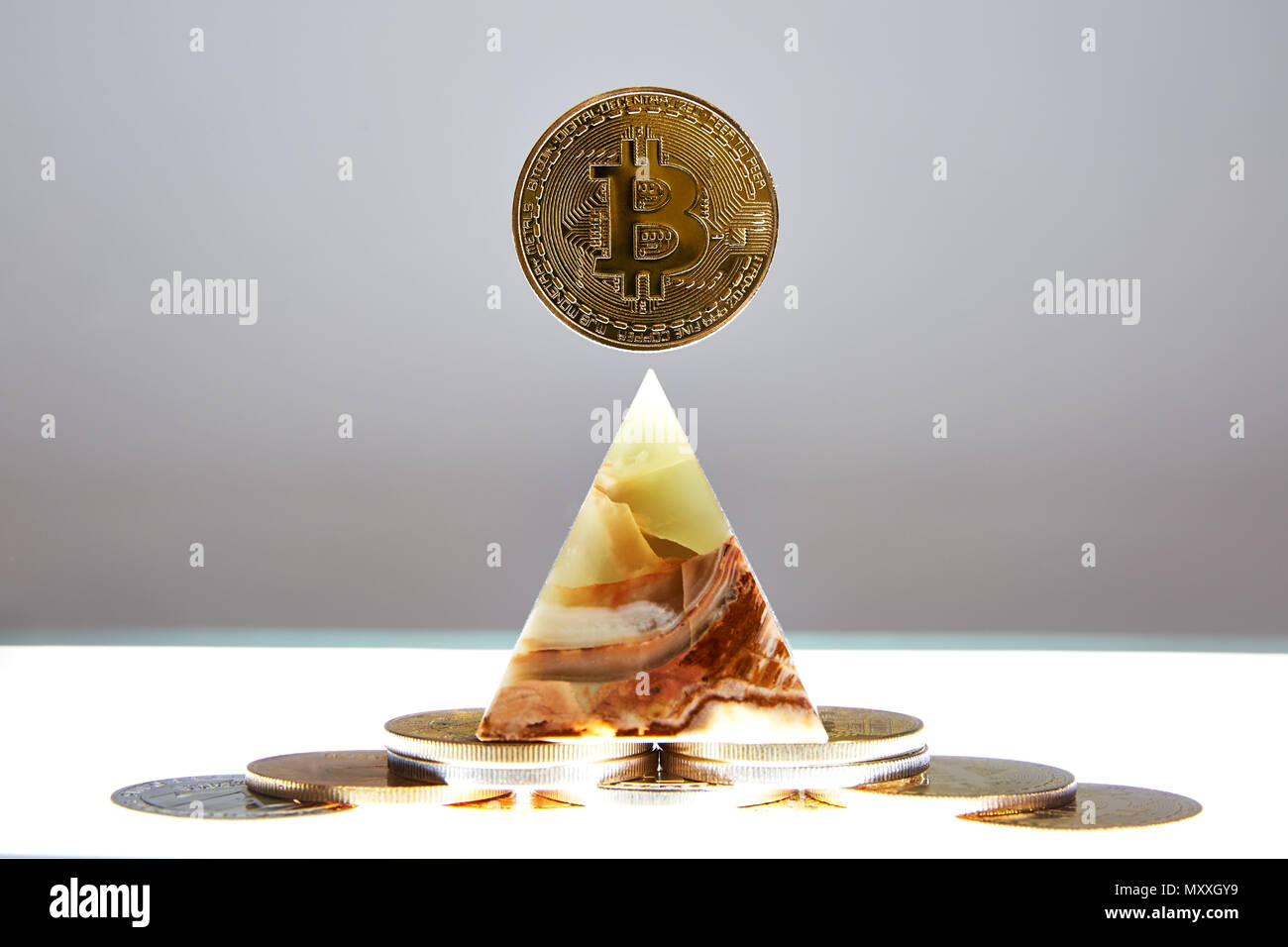 Bitcoin Coin sitting a top a translucent Onyx Stone. Stone symbolizes, personal power, change, facing fears.  All things people who trade crypro face Stock Photo