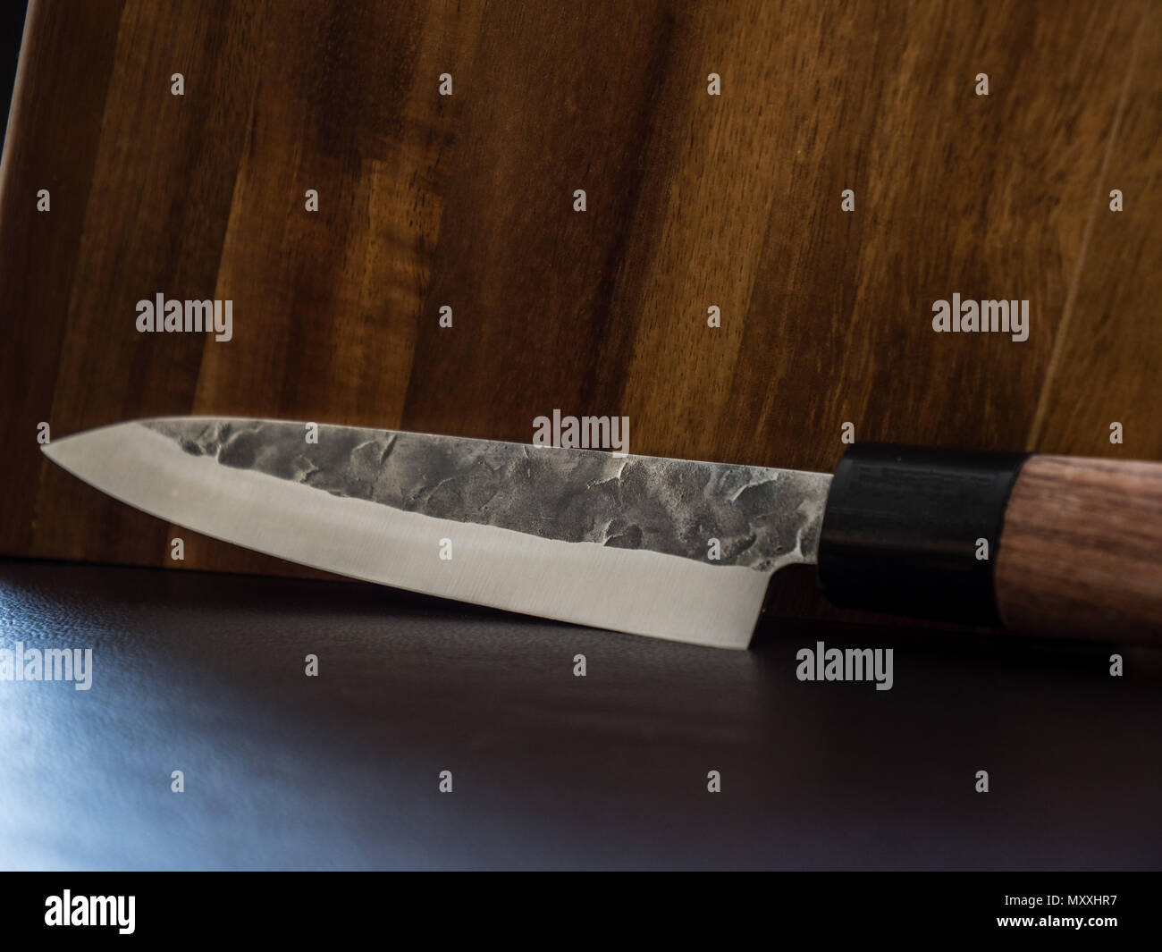 Knife with wood background damask leather surface Stock Photo