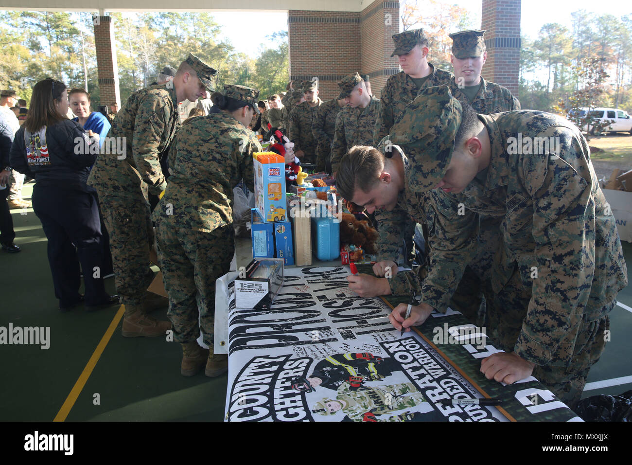 Service members sign a thank-you poster for the Nassau County Fire ...