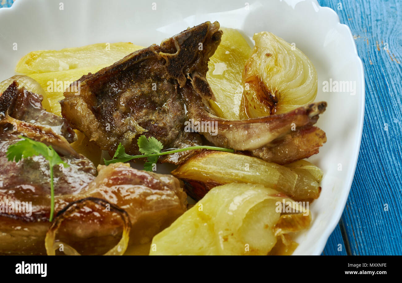 Mediterranean-style lamb chops, flavourful chop served with lots of healthy Mediterranean vegetables - Stock Image